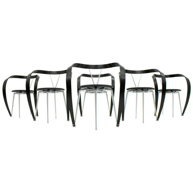Very decorative set of six dining chairs by Andrea Branzi for Cassina, 1993. New black leather seats, black painted curved...