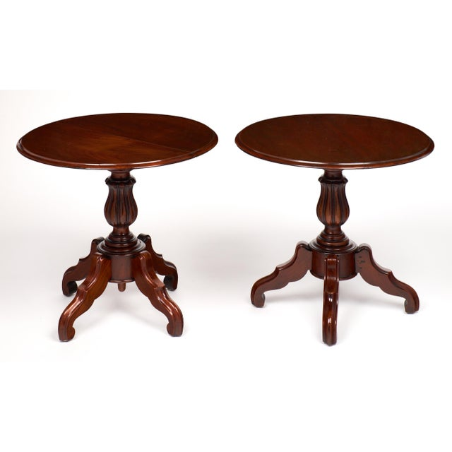 An exceptional pair of French antique faux side tables. From the Louis Philippe period made of hand-carved walnut with a...