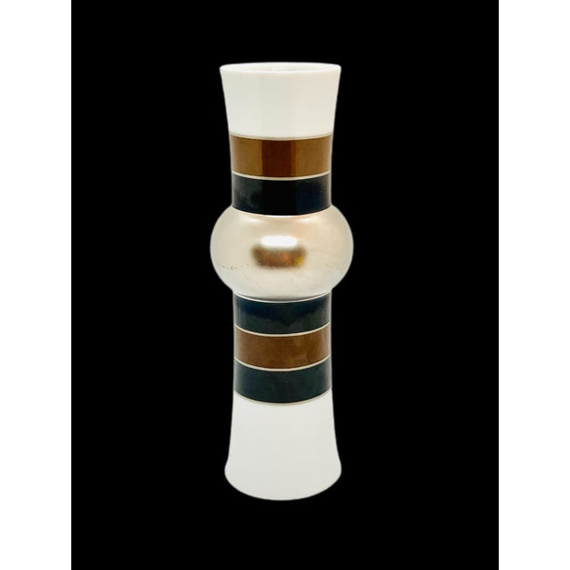A 1970's Rosenthal Studio Line porcelain hipped cylinder vase with banded silver glaze on the hip and rich black and brown...
