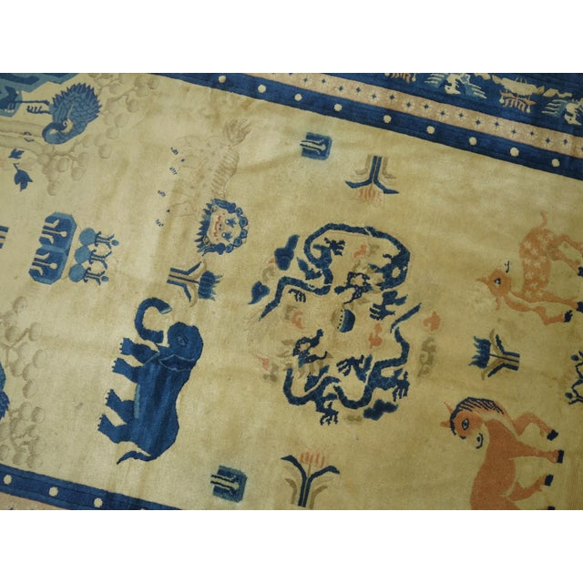 An early 20th century fine quality Chinese animal pictorial rug featuring an anonymous blue elephant. Decorative oriental,...