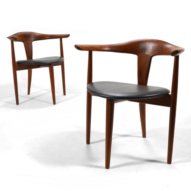 This exquisite pair of teak easy chairs were designed by Erik Andersen and Palle Pedersen and fabricatred by cabinetmaker...