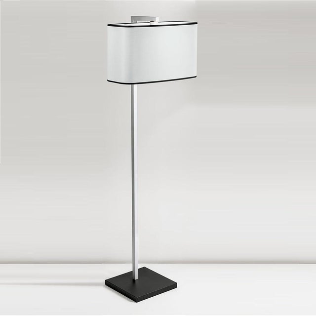Satin black with aluminium floor lamp with an up and over square section column which supports a bowed rectangular shade...