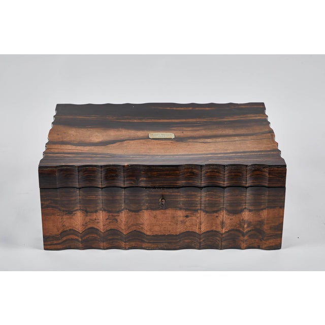 A gorgeous king ebony Inlaid Sri Lankan presentation box. Circa 1880's with all pieces included. Created to showcase an...