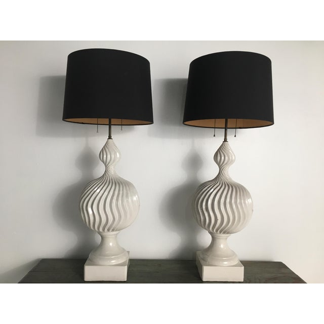 Large and impactful hand-crafted ceramic lamps with an exaggerated double gourd shape and wavy, textural ribbing. The...