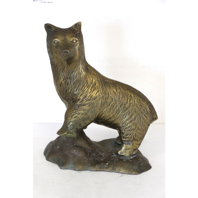 A brass bear figure standing on a rock mound with lifelike detailing throughout. No maker's mark. This is in very good...