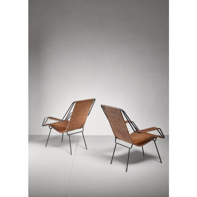 A pair of lounge chairs by Carlo Hauner and Martin Eisler, for their Forma company. The chairs are made of metal with a...