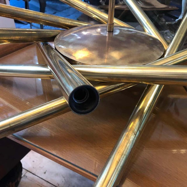 A Sputnik chandelier made in Italy in the 1950s by Stilnovo, brass has been cleaned but maintain his vibrant vintage look,...