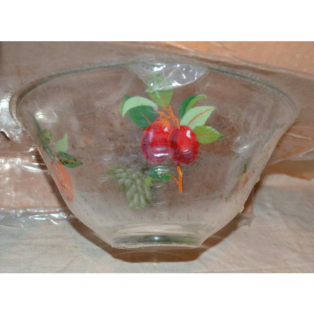 Glass fruit bowl with lithographs of fruit applied. New in package, 1980's. Perfect table centerpiece!
