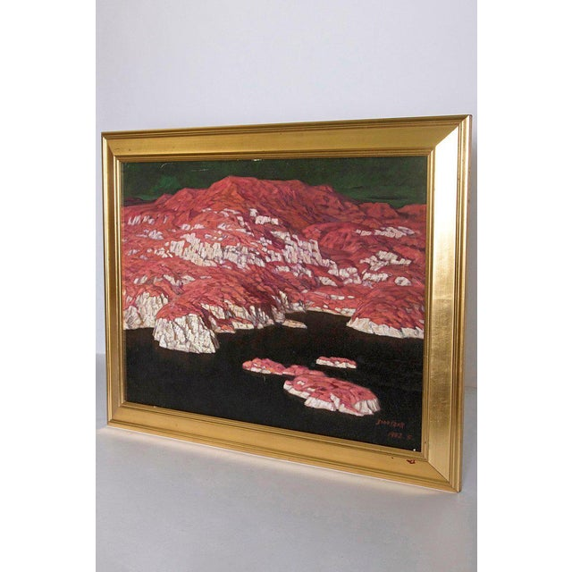 An abstract painting of mountains and seascape in blue, green and reds. The painting is indistinctly signed and dated...