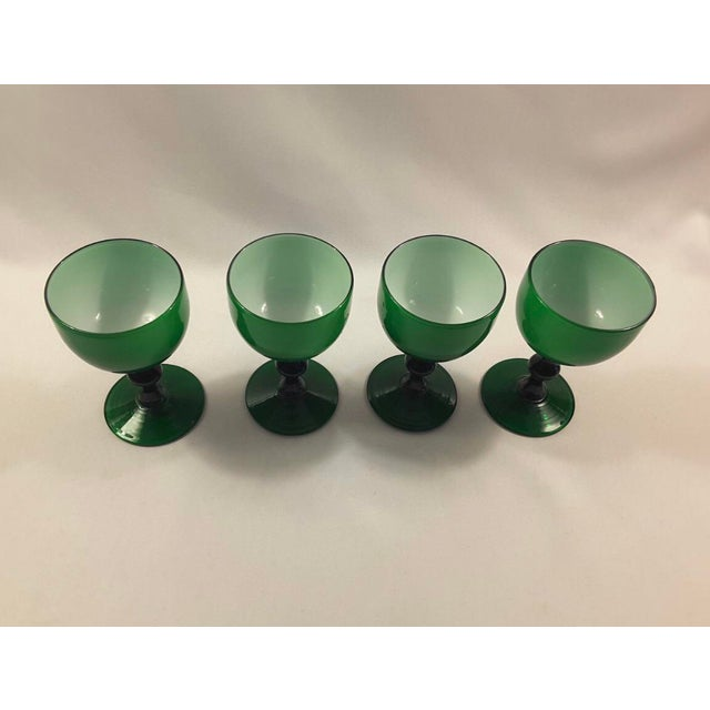 Set of 4 Carlo Moretti emerald green white cased wine glass coupes. Also available in pink, blue, black.