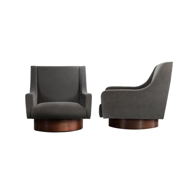 Mantled in 100% plush cotton velvet, these hefty occasional chairs are perched atop a solid walnut base. These classic and...