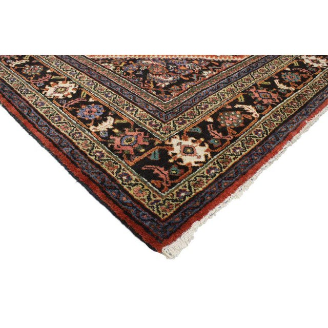 Bold and full of character, this antique Persian Mahal rug showcases an opulent cornucopia of lively Herati motifs on a...