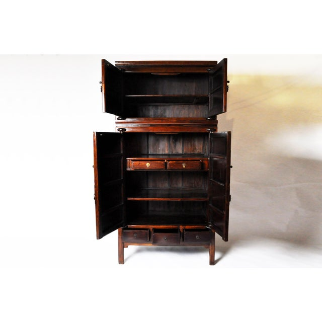 This handsome cabinet is from Ningbo, China and was made from cypress and hauli, c. 1810. The cabinet comes in two...