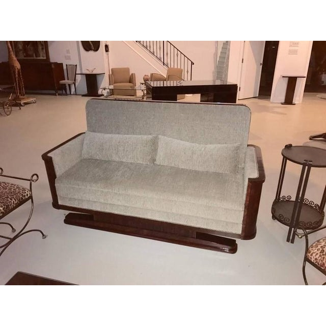 Stunning French Art Deco Macassar sofa. Having beautiful Macassar wood and deco lines. The silver nailheads are the...