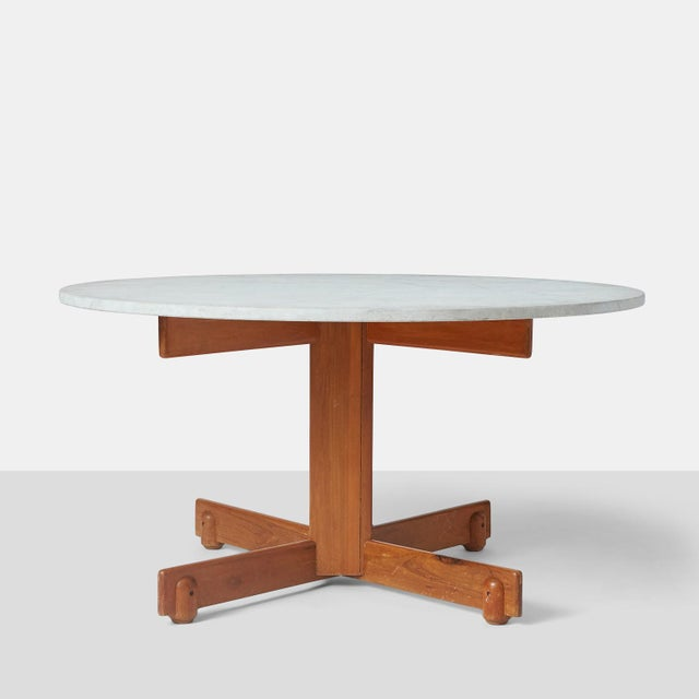 "Sergio Rodrigues ""Alex"" dining table. A dining table by Sergio Rodrigues with jacaranda base and etched white marble top...."