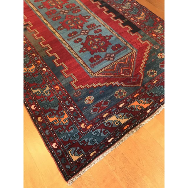 Antique Turkish Kazak Rug. Hand-knotted in Turkey. Geometrical and intricate pattern with blue accent shade. Characterized...