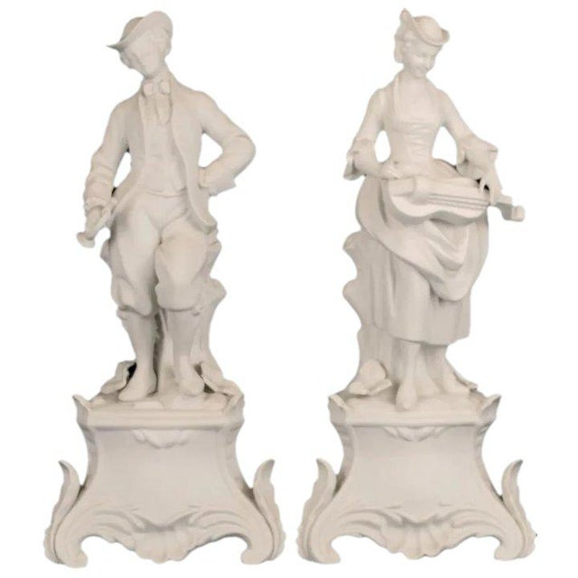 Nice bisque porcelain figures of a man and woman dressed in 18th century clothing. Made in Germany in the 1920's, these...