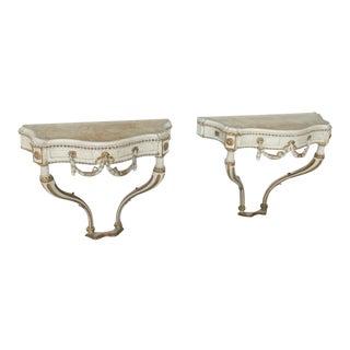 Pair of Italian Neoclassic Cream Painted, Parcel-Gilt Consoles For Sale