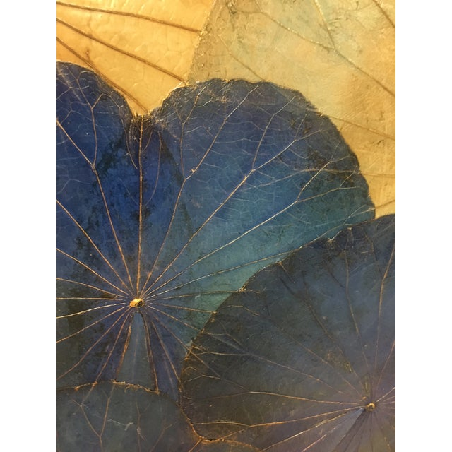 This is a set of 4 genuine lotus leaf pieces of wall art. The entire set measures out at about 40 square inches when hung.