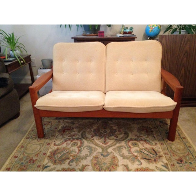 Mid-Century Modern loveseat in teak wood made by Domino Mobler in Denmark ('50s-'60s). Excellent condition - very clean....