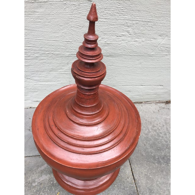 Majestic and elegant urn collected on an Asian holiday in 60's . This wooden offering urn looks like solid terra cotta,...