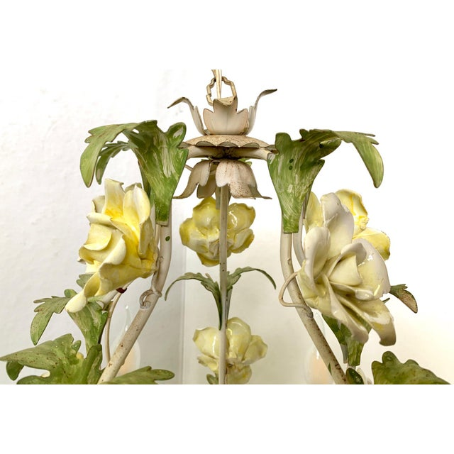 Italian toile floral porcelain and metal vintage chandelier. Sweet and delicate yellow flowers and greenery adorn the...