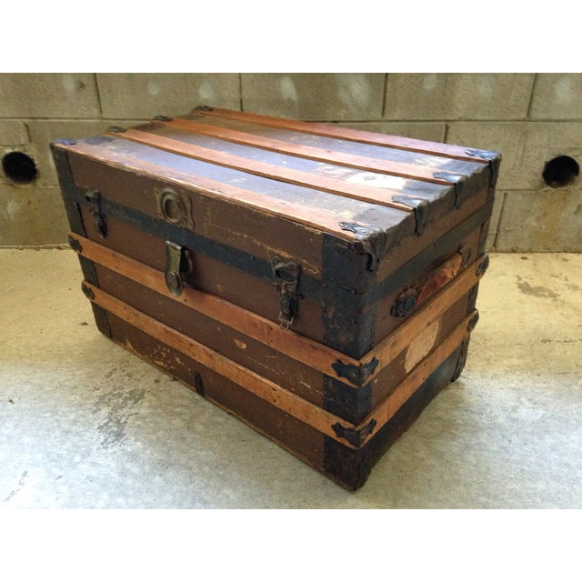 Fantastic antique steamer trunk or stage coach trunk. This trunk is in beautiful antique shape with wear and patina, both...