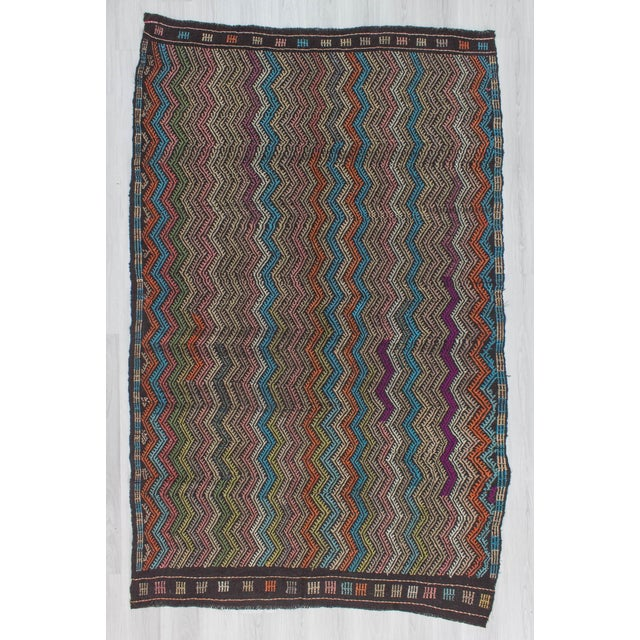 Offered is an embroidered kilim rug from Denizli region of Turkey. In good condition. Approximately 45-55 years old.