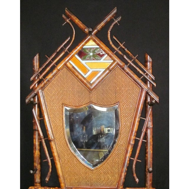 Art Nouveau 19th Century Art Nouveau Bamboo Woven Back Hall Tree With Beveled Shield Mirror and Nouveau Lamajolique - Societe Anonyme Tile For Sale - Image 3 of 9