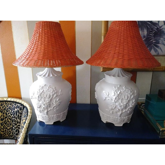 A stunning pair of vintage large plaster pagoda table lamps topped with custom painted wicker pagoda shades. They lamps...