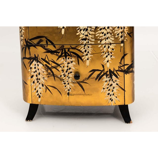INQUIRE ABOUT SHIPPING PRIOR TO PURCHASE Early 20th century pair of gold lacquered two drawer Chinese chests with black...
