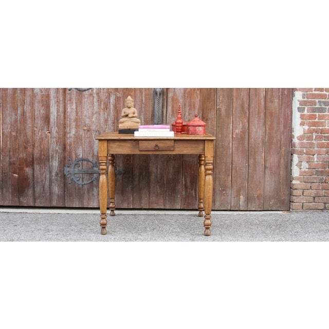 Rustic and beautifully aged, this farmhouse kitchen table was made using chestnut wood and boasts a light brown hue. This...