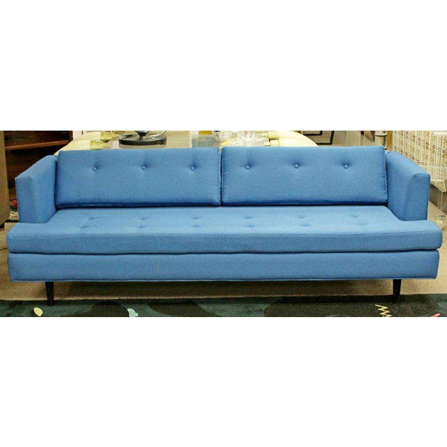 For your consideration is a wonderful, tufted, blue sofa, on wooden legs, circa 1960s. Upholstery is Knoll fabric. In...