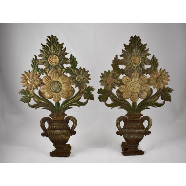 A pair of Tôle Peinte standing urns showing bouquets of stylized flowers, circa early 1800's. Most likely French or...