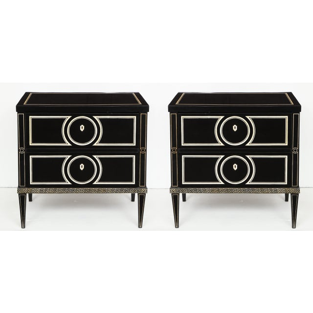 Graphic Black and White Pair of Ebonized Commodes featuring Neoclassic Hand-painted Decoration, Reminiscent of...