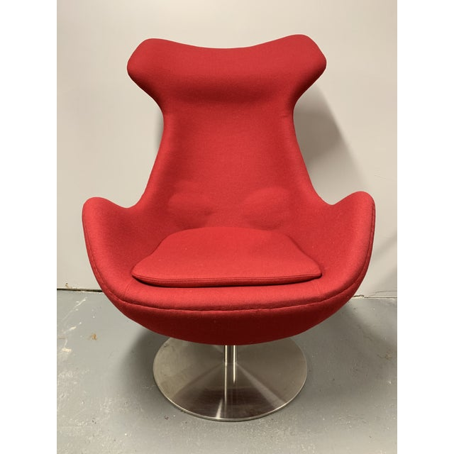 Elegant high back swiveling reclining lounge chair by Steijer Furniture. Is in great condition and features a foam covered...