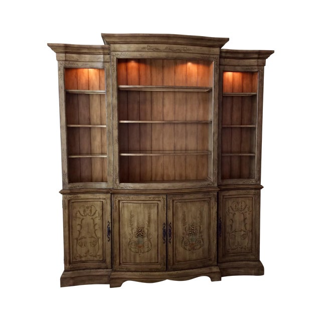 """This """"Seven Seas"""" by Hooker two piece wall unit is featured in a elegantly distressed earth tone of green and brown with..."""