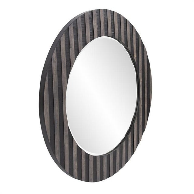Winchester Round Mirror Our Winchester Mirror is an interesting piece featuring a round wood frame characterized by a...