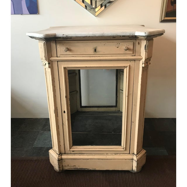 This is a one of a kind 19th century marble topped cabinet from a cafe in Paris that was used to hold silverware and...