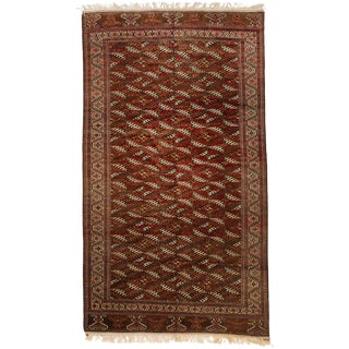 Antique Persian Turkmen Rug With Black & White Diamond Patterns on Red Field For Sale