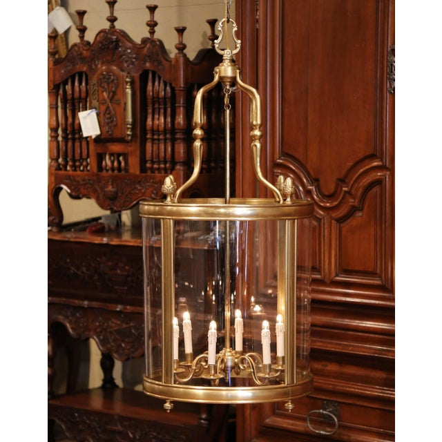 Illuminate your entryway with this large brass lantern light fixture. Crafted in France circa 1960, the tall, mid-20th...