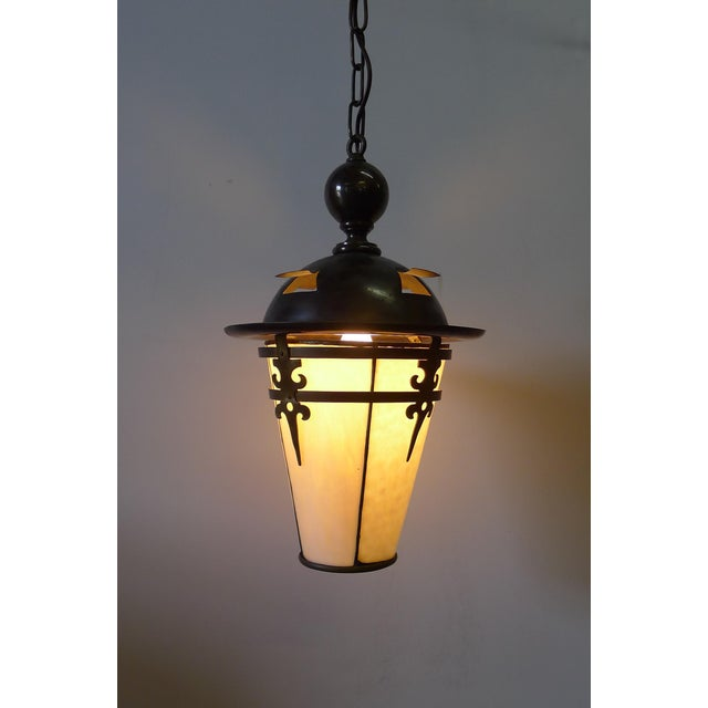 Early 20th Century Arts & Crafts, Gothic Revival lantern pendant. Original with patina. With new electrical (porcelain...