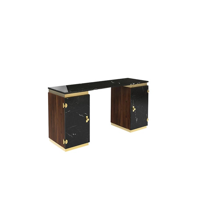 Lasdun is a writing desk inspired in the brutalist works of Denys Lasdun. It features two cubic towers crafted from...
