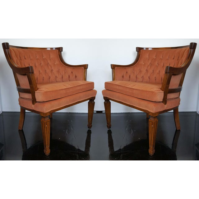 A pair of comfortable, small-scale barrel-back accent chairs, perfect for a smaller living space or as host dining chairs....