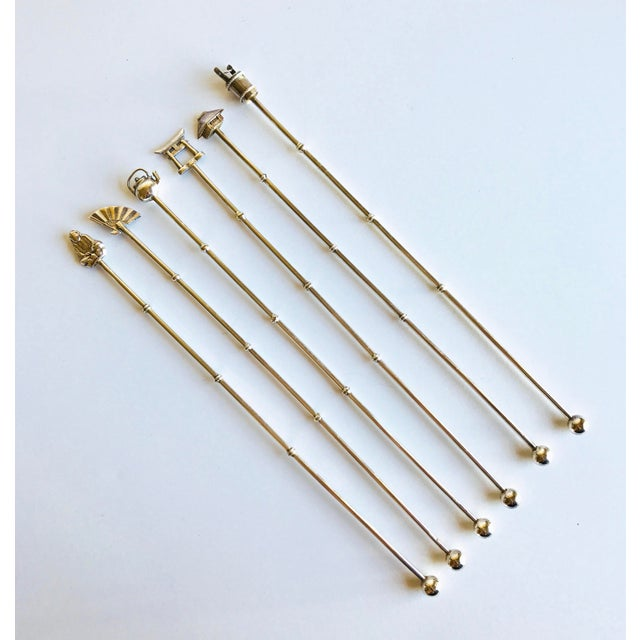 Set of 6 sterling silver cocktail stirrers. Bamboo style stem, with Japanese motif tips. Each stirrer measures approx...