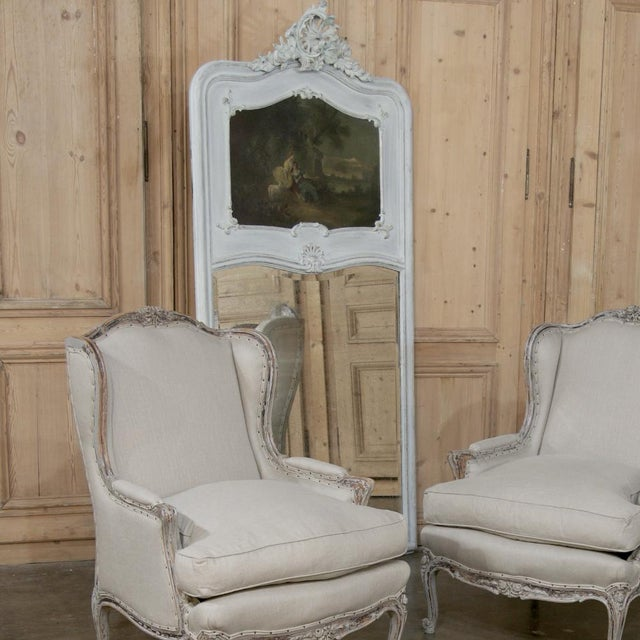 This beautiful 19th Century French Louis XV Painted Trumeau/Mirror features the naturalistic styling of the Rococo...