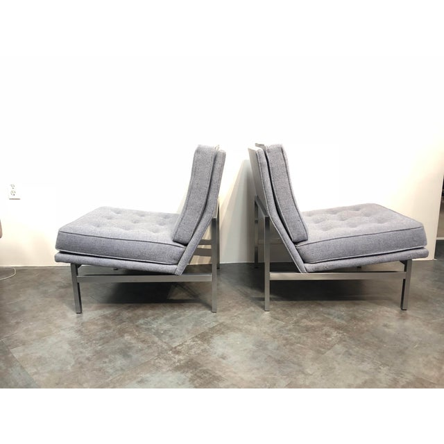 Pair of early generation Florence Knoll for Knoll Associates armless slipper or lounge chairs with solid stainless steel...
