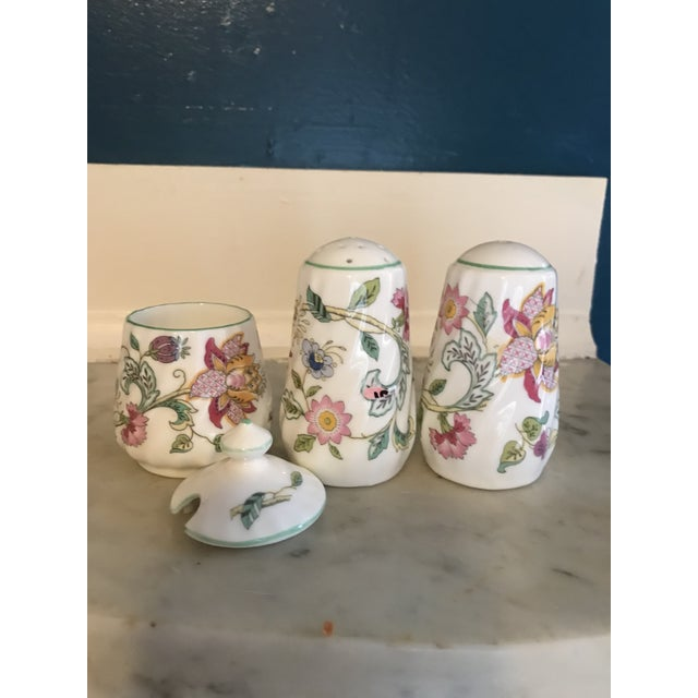 This set of Minton China salt and pepper shakers come with a lidded mustard pot and are in the Haddon Hall design. The...