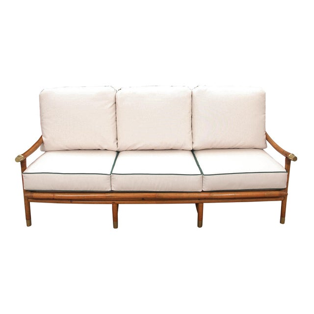 1950s sofa by John Wisner for Ficks Reed. The frame is of solid wood construction with rattan wrapped joinery. The back...