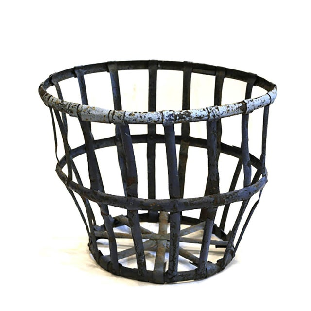 Large iron distressed metal basket. Very sturdy. Possibly used in a foundry or factory.